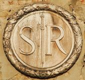 San Rocco symbol. Saint Roch parish old symbol on a wall in Venice royalty free stock images