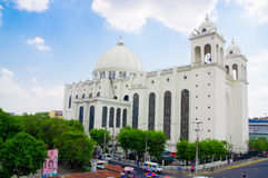 San salvador. El Salvador - May-04-2014: Front view of the The Metropolitan Cathedral of the Holy Savior in the citys main square with pigeons Stock Photo