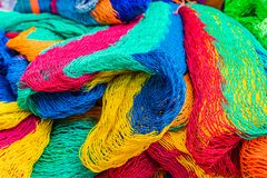 A typical view in San Salvador, El Salvador. San salvador, El salvador. January 2018. Colourful fishing nets for sale in a market in San Salvador, El Salvador Stock Image