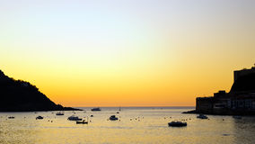 San Sebastian Bay at sunset. San Sebastian Bay from Concha beach on a summer end sunset Royalty Free Stock Photos