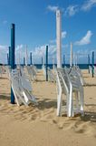 San Sebastian beach. Sunshade San Sebastian Beach Sand Spain Chair Royalty Free Stock Image