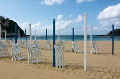 San Sebastian beach. Sunshade San Sebastian Beach Sand Spain Chair Stock Photo