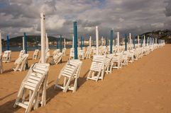San Sebastian beach. Sunshade San Sebastian Beach Sand Spain Chair Stock Photography