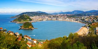 San Sebastian city, Spain, view of La Concha bay and Atlantic ocean. San Sebastian - Donostia city, Basque country, Spain, panoramic view with La Concha bay stock photos