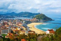 San Sebastian - Donostia city, Basque country, Spain. View of the Zurriola beach, Urgull mount, La Concha bay, surrounding Pyrenees mountains and Atlantic stock image