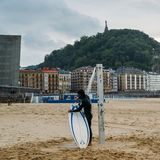 San Sebastian or Donostia is a coastal city and located on the coast of the Bay of Biscay, Spain. Surfer on the coast Royalty Free Stock Images