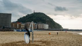 San Sebastian or Donostia is a coastal city and located on the coast of the Bay of Biscay, Spain. Surfer on the coast Royalty Free Stock Photography