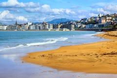 San Sebastian - Donostia, Spain, Basque Country. View of Ondarreta sand beach, La Concha bay and city skyline royalty free stock image