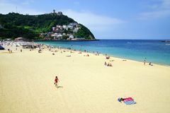 SAN SEBASTIAN, SPAIN - JULY 24, 2018: Ondaretta Beach, Spain. San Sebastian or Donostia is a coastal city and municipality located on the southern coast of the stock photography