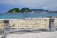 SAN SEBASTIAN, SPAIN - JULY 24, 2018: Playa la Concha seen from the Concha promenade - Kontxa Pasealekua in basque. San Sebastian or Donostia is a coastal city royalty free stock images