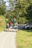 Pilgrims with backpacks on their backs. San Sebastian, Spain-September 2018. Pilgrims with backpacks on their backs in the mountains of spanish basque country in stock photo