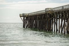 San Simeon pier, California, USA from the beach stock photo
