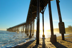 San Simeon pier with waves, near Hearst Castle, California, USA. Wide view of pier near Hearst Castle, San Simeon and Cambria, California, USA Royalty Free Stock Photos