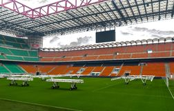 San Siro arena. Grass caring equipment on the field of San Siro stadium. Milan, Italy royalty free stock photography
