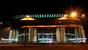 San Siro football stadium in Milan, Italy. Night view of the famous San Siro soccer stadium in Milan, Italy, where Milan and Inter teams play stock photos