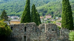 San Siro in Lake Como, with the castle, old fortress Rezzonico. Ruins wall stock photos