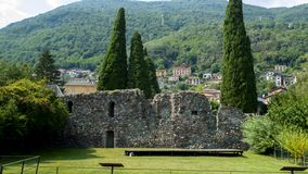 San Siro in Lake Como, with the castle, old fortress Rezzonico. Ruins wall stock images