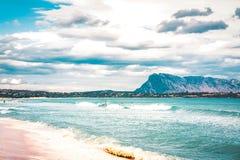 San Teodoro, Italy - September 10, 2017: La Cinta beach and Blue waters of Mediterranean Sea at San Teodoro on Sardinia Island in. Italy. Tavolara Island seen royalty free stock photography