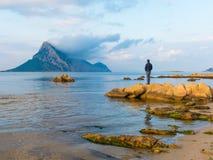 beautiful shallow blue water bay overlooking Isola Tavara island of Sardinia stock photo