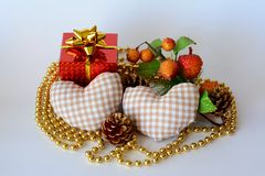 San valentine gift. A gift box two hearts necklace gold and decorated Stock Photography