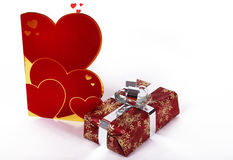 San valentine's card. A red san valentine's card and a gift Royalty Free Stock Photo