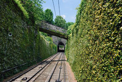 San Vigilio funicular railway. Working funicular of Colle di San Vigilio hill in Bergamo. Cable railway from the Lower Town to the Upper Town. Wall overgrown stock photography