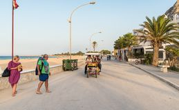 People walking on the promenade in San Vito Lo Capo. royalty free stock photos