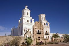 San Xavier Del Bac Mission. Mission San Xavier del Bac south of Tucson Arizona has been recently restored.  This image shows two bell towers with cross on the Stock Photography