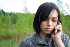 San young girl talking on telephone. Portrait of the san young girl talking on mobile telephone Royalty Free Stock Photos