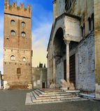 San Zeno Abbey. Entrance of the San Zeno Basilica and the tower of the abbey, in Verona, Italy Royalty Free Stock Photography