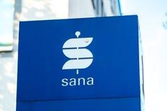 Sana Immobilien Company signage. Berlin, Germany - April 19, 2018: Signage of Sana Immobilien Service GmbH, service company of Sana Klinik AG advising Sana`s Stock Image