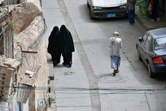 Sanaa, street scene with veiled muslim women and men. Yemen Royalty Free Stock Image