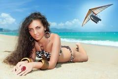 Sanbathing. Sunbathing woman. Flying boat on the bbackground Stock Photography