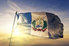 Sanchez Ramirez Province of Dominican Republic flag textile cloth fabric waving on the top sunrise mist fog. Beautiful royalty free stock photos