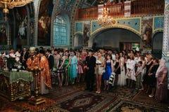 Sanctifies graduates in the church Stock Photo