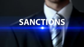 Sanctions, businessman in front of screen, danger prevention, prohibition stock photography