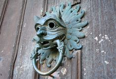 Sanctuary. Medieval knocker on wheathered door at Durham Cathedral royalty free stock images