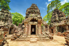 Sanctuary of ancient Ta Som temple, Angkor, Siem Reap, Cambodia. Sanctuary of ancient Ta Som temple on blue sky background. Enigmatic Ta Som nestled among Stock Photography