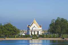 Sanctuary behind the pond. White sanctuary at central of Buddhism in Thailand Stock Photography