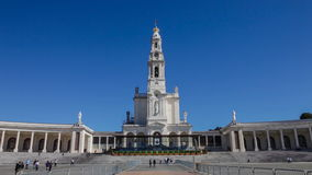 Sanctuary of Fatima, Portugal. Basilica of Our Lady of the Rosary and colonnade with devotees and pilgrims. Fatima is one of the most important pilgrimage stock footage