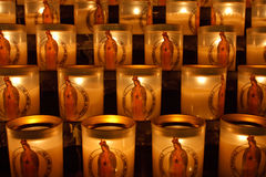Sanctuary lamps in Notre Dame. Burning candles in a corner of Notre Dame Royalty Free Stock Photos