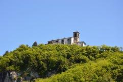 The sanctuary Santuario della Madonna della Ceriola in Monte Isola on the top of green hill, Lake Iseo, Italy Stock Photo