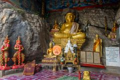 Sanctuary with sitting Buddha in the cave. Laos Royalty Free Stock Photos