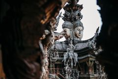 Sanctuary of Truth is a temple construction in Pattaya, Thailand. The sanctuary is an all-wood building filled with sculptures stock photos