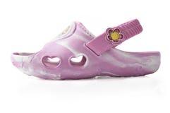 Sandálias das crianças em um fundo branco Imagens de Stock Royalty Free