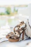 Sandálias de couro no tapete Imagens de Stock