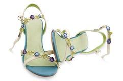 Sandálias fêmeas isoladas no fundo branco Imagem de Stock Royalty Free