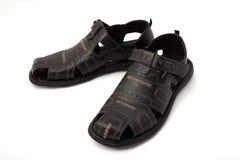 Sandálias pretas no branco Fotos de Stock