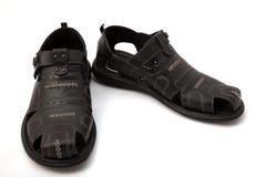 Sandálias pretas no branco Fotos de Stock Royalty Free