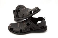 Sandálias pretas no branco Fotografia de Stock Royalty Free